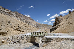 Metall construction bridge across river in mountains Royalty Free Stock Photos