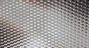 Metall mit Licht reflektieren sich Stockbild