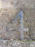 Metall nummer fyra i trottoar Royaltyfria Foton