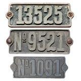metall numrerar gammalt Arkivfoto