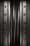 Metall på den svarta gardinen royaltyfria bilder