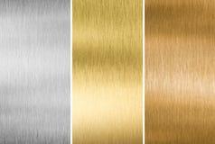 Metall texturerar guld, silver och brons arkivbild