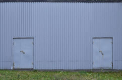 Metall wall texture with two doors Royalty Free Stock Photo