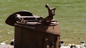 Metallabfälle nahe einem Fluss stock video footage
