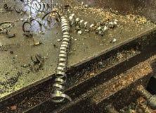 Metallabfall auf Maschine lizenzfreies stockbild