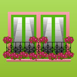 Metallbalkon mit hellen Pelargonien Stockbilder
