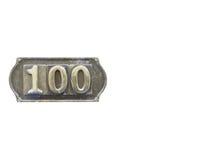 Metalletikett med numret 100 Fotografering för Bildbyråer
