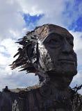 Metallgesichtsskulptur Stockfoto