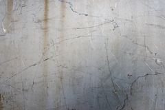 Metallgrauer alter Türhintergrund mit Kratzern Stockbilder