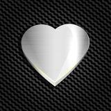 Metallhjärta på ett bakgrundsingrepp av kolhydraten, websites och vykort För lyckönskan på dag för valentin` s Fotografering för Bildbyråer