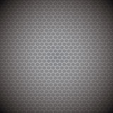 Metallic abstract background. With a honeycomb backdrop Stock Photos