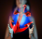 Metallic anchor on futuristic  hologram Stock Images