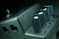 Metallic audio regulator of digital guitar pedal Stock Image