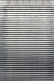 Metallic background. Made of horizontal lines Stock Images
