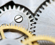 Metallic Background with metal cogwheels clockwork. Macro Stock Photo
