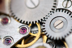 Metallic Background with metal cogwheels a clockwork. Macro Stock Photos