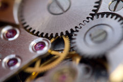 Metallic Background with metal cogwheels  clockwork. Macro Stock Photography