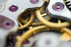 Metallic Background with metal cogwheels a clockwork. Macro Royalty Free Stock Images
