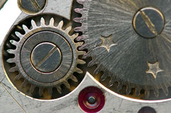 Metallic Background with metal cogwheels a clockwork. Macro Stock Photography