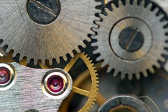 Metallic Background with metal cogwheels a clockwork. Macro Stock Image