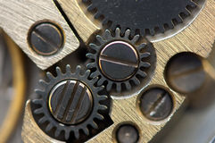 Metallic Background with metal cogwheels a clockwork. Macro Royalty Free Stock Image