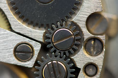 Metallic Background with metal cogwheels a clockwork. Macro Royalty Free Stock Photo