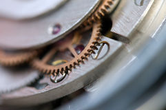 Metallic Background with metal cogwheels a clockwork. Macro Royalty Free Stock Photography