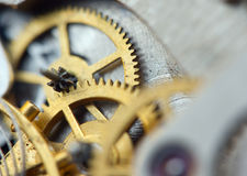 Metallic Background with metal cogwheels a clockwork. Macro Royalty Free Stock Images