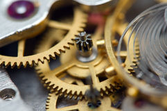 Metallic Background with metal cogwheels a clockwork. Macro Royalty Free Stock Photo