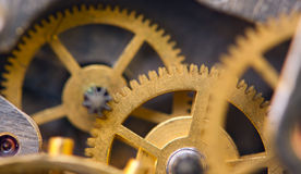 Metallic Background with metal cogwheels a clockwork. Macro Royalty Free Stock Photos