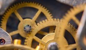 Metallic Background with metal cogwheels a clockwork. Macro Royalty Free Stock Photos