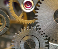 Metallic Background with metal cogwheels a clockwork. Macro Stock Photo