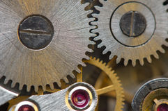 Metallic Background with metal cogwheels a clockwork. Macro Stock Images
