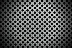 Metallic Background with Round Holes. Detail of a metallic background with round holes and shadows Stock Photo