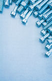 Metallic background with stainless hexagon bolts Stock Image