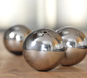 Metallic balls. Metallic spheres for the salt and the pepper Stock Image