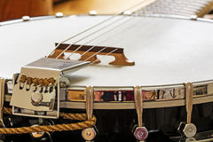 Metallic banjo with 6 strings, music instrument detail Royalty Free Stock Images