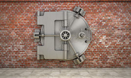 The metallic bank vault door on the brick wall. Stock Photos