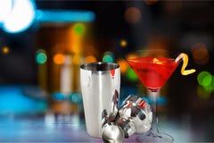 Metallic barman shaker with cocktail on bar stock photo