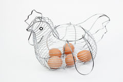 Metallic basket of eggs shaped hen Royalty Free Stock Photo