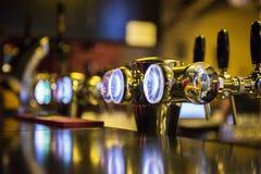 Metallic beer taps Stock Images