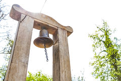 Metallic bell on wooden beam Royalty Free Stock Images
