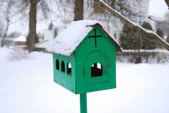Metallic birds feeder in winter Stock Photo