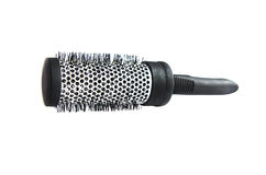 Metallic black comb on a white background. Isolated Stock Photo