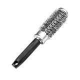 Metallic black comb on a white background Royalty Free Stock Image