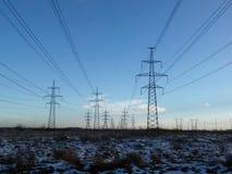 Metallic black mast power lines Royalty Free Stock Photo
