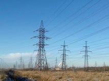 Metallic black mast power lines Royalty Free Stock Photos
