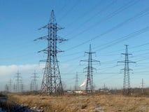 Metallic black mast power lines Royalty Free Stock Images