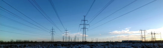 Metallic black mast power lines Stock Image