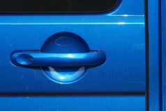 Metallic blue car door handle Stock Photos